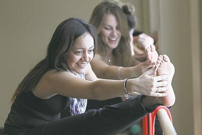 Barre classes use elements of ballet and Pilates to strengthen and tone.