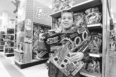 Alex Kirbyson helped pick out toys for some very happy kids.