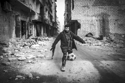 Andoni Lubacki / The Associated PressA Syrian rebel plays football in the Saif al-Dawlah neighbourhood of Aleppo, Syria, Wednesday. The UN gave a grim count of 60,000 casualties over the last 21 months.