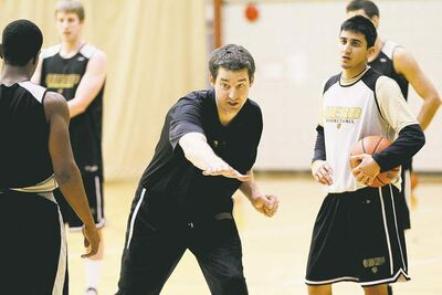 John Woods / Winnipeg Free Press University of Manitoba Bisons men�s basketball coach Kirby Schepp works with his players during a practice at the university Tuesday.