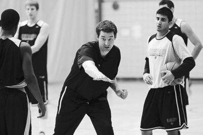 U of M men's Bison basketball coach Kirby Schepp works with players on Tuesday.