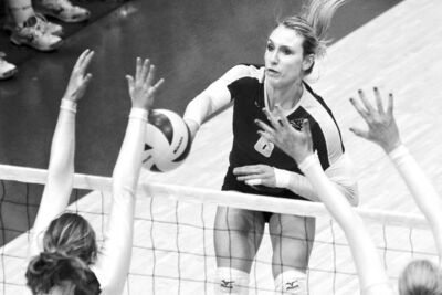 Mike Deal / Winnipeg Free PressBisons hitter Rachel Cockrell thunders a spike during a match against the University of Regina Cougars at Investors Group Athletic Centre on Sunday afternoon.
