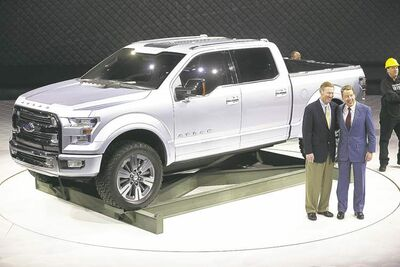 Ford Motor Co.  Executive Chairman Bill Ford, right, and President and CEO Alan Mulally stand next to the Ford Atlas concept pickup after its unveil at the recent Detroit auto show.