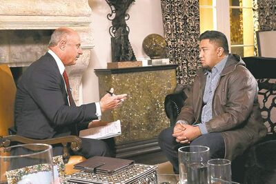 AP Photo  /CBS Television Distribution / Peteski ProductionsHost Dr. Phil McGraw (left) interviews Ronaiah Tuiasosopo during a taping for the Dr. Phil Show.