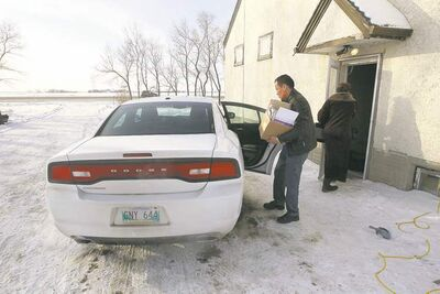 Chief Adrian Sinclair loads his rented Dodge Charger.