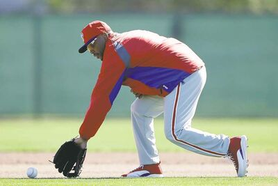 Matt Slocum / the associated press archivesJimmy Rollins chases down a ball during a workout at spring training earlier this week in Clearwater, Fla. He�s not talking trash, but he�s confident about the club.