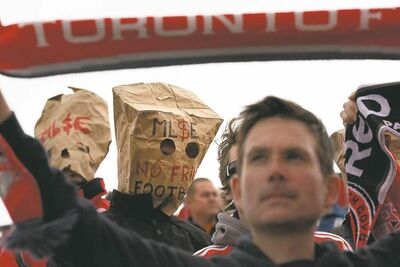 Chris Young / the canadian press archivesToronto FC fans jeer on their hapless team of misfits and screw-ups at a MLS game last season.