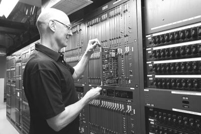 HandoutTechnician Paul Jarvis was one of 200 involved in implementing 10-digit dialing.