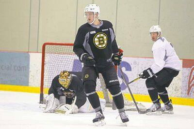 Rookie blue-liner Dougie Hamilton is enjoying every second of life with the Bruins. Here, he�s stretching his legs at an optional skate on Monday.