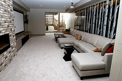 Downstairs, a media room contains a 70-inch flat-panel television.