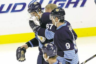 Gene J. Puskar / the associated pressPittsburgh captain Sidney Crosby (87) is helped off the ice by linemate Pascal Dupuis after being hit in the face by a shot Saturday afternoon.
