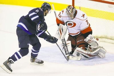 Defenceman Ron Hainsey had perhaps his best chance to score his first goal as a Winnipeg Jet Saturday, but Hurricanes goalie Justin Peters shut the door.