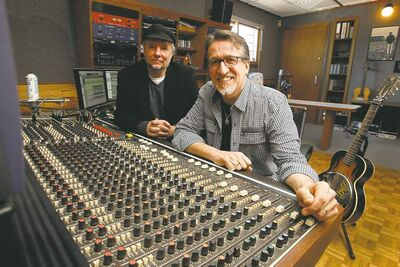 Steve Bell (right), with his longtime manager, Dave Zeglinski, will be honoured by the WSO for his contributions to the musical life of Winnipeg.