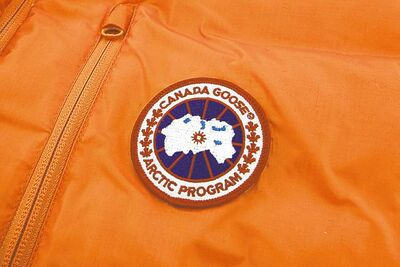 The firm's official logo is stitched onto a parka.