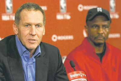 Toronto Raptors general manager Bryan Colangelo (left) sits with head coach Dwane Casey during a  press conference in Toronto on Wednesday, Dec. 7, 2011.