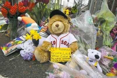 Residents have set up a memorial with flowers and stuffed toys to honour the victims of the Boston Marathon bombings.