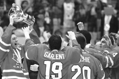 Canadian players celebrate their 3-2 gold-medal victory over the U.S. in the under-18 world championship in Sochi, Russia Sunday.