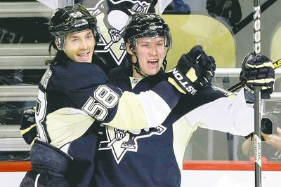 Pittsburgh's Beau Bennett (right) celebrates his first-period goal with blue-liner Kris Letang Wednesday night.