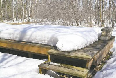 Snow is one reason an unmaintained deck will turn grey within a couple of years. Note how the vertical rim joist has retained its original cedar-tone colour.