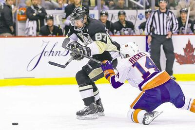 Pittsburgh's Sidney Crosby zips past  Islanders blue-liner Thomas Hickey on his way to  a breakaway goal in the second  period Thursday night.