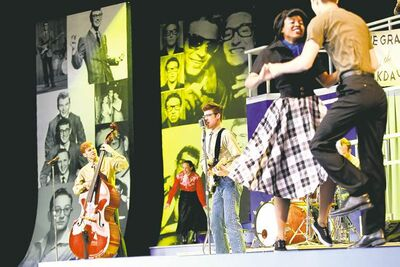 Jeff Giles stars as Buddy Holly (centre) in Rainbow Stage's biographical jukebox musical.