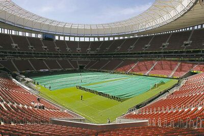 Workers prepare Brasilia's National Mane Garrincha Stadium for the opening ceremony of the Confederations Cup.