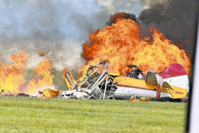 photos by than v. tran / the associated pressFlames erupt from a stunt plane after it crashed while performing with a wing walker at the Vectren Air Show in Dayton, Ohio.