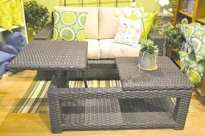 Haven love seat, $1,795, and coffee table with adjustable top to create a work surface, $725, at The Garden Room.