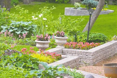 Precast stack stone can be used to create raised beds that follow the contours of your landscape and compliment the exterior design of your home. Build your own nutrient-rich, moisture-retentive soil with a custom recipe that includes vermiculite, compost, aged manure or worm castings.