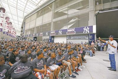 the associated pressKirk Smalley speaks to students, teachers and parents from local schools and community groups as part of an anti-bullying presentation at Yankee Stadium.