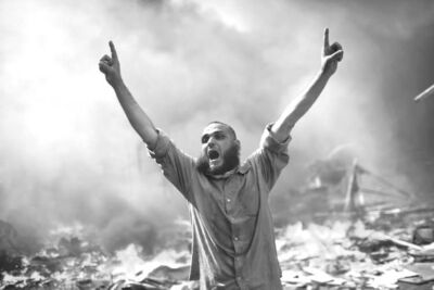 AP10ThingsToSee - A supporter of ousted Islamist President Mohammed Morsi shouts during clashes with Egyptian security forces in Cairo's Nasr City district, Egypt, Wednesday, Aug. 14, 2013. (AP Photo/Manu Brabo, File)