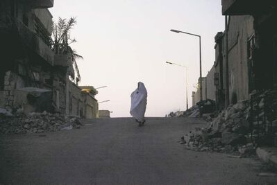 A woman walks through the ruins of Sirte, former Libyan dictator  Moammar Gadhafi's hometown,  and the last regime stronghold  to fall during the revolution in 2011.