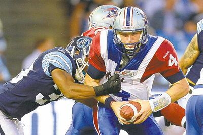 Alouettes QB Tanner Marsh is punished by Toronto's Matt Black.