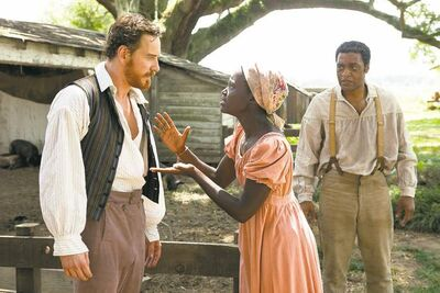 Chiwetel Ejiofor, right, is Solomon Northup, the title character who is kidnapped and sold into slavery in 12 Years a Slave.
