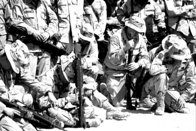 American troops pray before going into battle in Iraq in 2003.