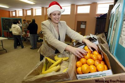 Amy Ihrke stocks Agape Table's affordable alternative co-op grocery store. The charity is hosting a free turkey dinner from 8:30 a.m. to noon the day before Christmas at its 175 Colony St. location. On a regular basis, it offers subsidized breakfasts for low-income people between 8 a.m. and 11 a.m. It accepts donations of non-perishable food and quality clothing.