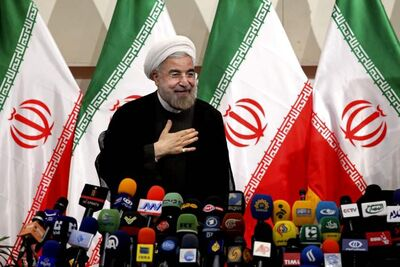 "Iranian newly elected President Hasan Rowhani, places his hand on his heart as a sign of respect, after speaking at a press conference, in Tehran, Iran, Monda. Rowhani showcases his reformist image by promising a ""path of moderation,"" the easing of nuclear tensions and steps to narrow the huge divide with the United States."