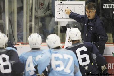 Winnipeg Jets head coach Claude Noel goes over some basics on the first day of camp Saturday at the MTS Iceplex.