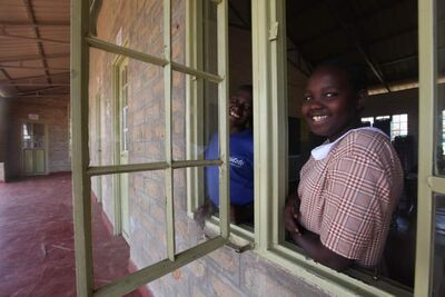 Students attend school in a classroom built by a previous team of volunteers.