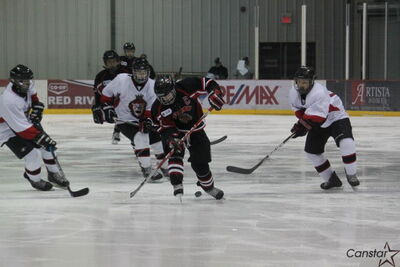Hawks captain Ben Dalke takes the puck from a Central Plains Capitals defender.