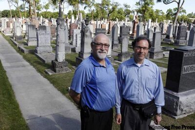 Ian Staniloff (left) and Rabbi Alan Green of Congregation Shaarey Zedek at the synagogue's cemetery on Armstrong Avenue.