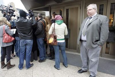 Mark Stobbe waits as his lawyer, Tim Killeen, speaks to the media on Thursday after Stobbe was acquitted of killing his wife.