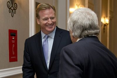 NFL Commissioner Roger Goodell, left, and New England Patriots football team owner Robert Kraft talk as they arrive for the NFL fall meeting in Washington, Tuesday, Oct. 8, 2013. (AP Photo/Carolyn Kaster)