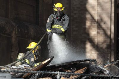 Firefighters battle a blaze at Laura Secord School.