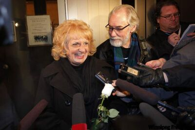 Wilma and Cliff Derksen leave the Law Courts building in Winnipeg Friday evening after the jury ruled Mark Grant killed their daughter Candace in 1984.