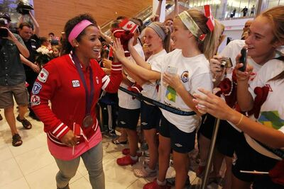 Soccer Olympian and bronze medalist Desiree Scott is given a hero's welcome at the Winnipeg airport when she returned home last summer.
