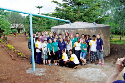 Kildonan-East Collegiate's contingent of travellers is shown by their rainwater-collecting tanks during the school's visit to Tanzania last month.