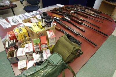 Selkirk RCMP display a number of firearms and other weapons, including knives, bear spray and ammunition that were collected during an investigation the police have dubbed Project Deduct.