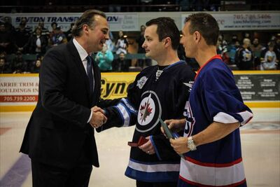Rod Bruinooge, Member of Parliament for Winnipeg South (centre), along with Barrie, Ont. MP, Patrick Brown, present a Queen Elizabeth II Diamond Jubilee Medal to Winnipeg Jets legend and Coach of the Barrie Colts, Dale Hawerchuk, on Saturday.