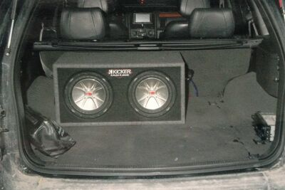 The trunk of Davis's jeep as police initially found it in March 2008. Note the black items on the bottom right toward the door.